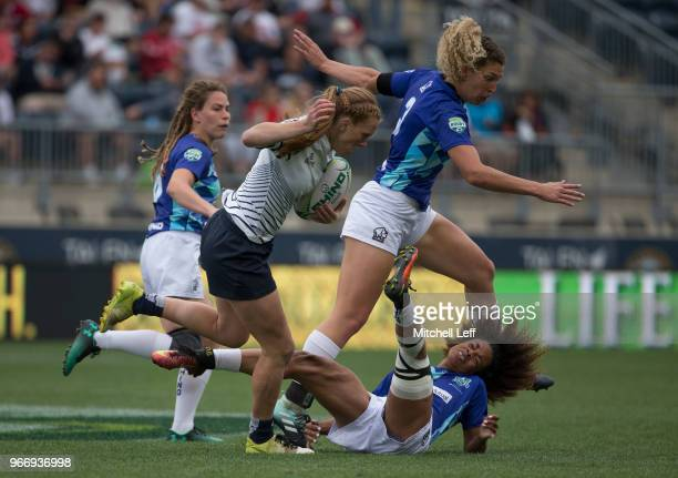 Rachel Ehrecke of Penn State runs with the ball against Anna Elder Ally Gallagher and Shae Ferguson of NSCRO in the semifinals during day 2 of the...