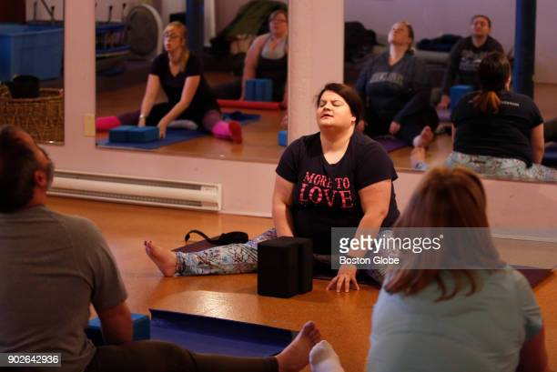 Rachel Estapa the creator and yogi behind More to Love Yoga leads one of her yoga classes in Somerville MA on Dec 17 2017 More to Love Yoga...