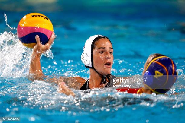 Rachel Fattal of United States is challenged by Beatriz Ortiz Munoz of Spain during the Women's Water Polo gold medal match between the United States...