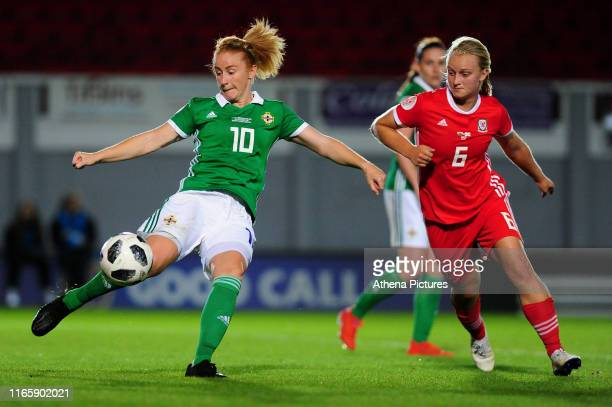 Rachel Furness of Northern Ireland vies for possession with Elise Hughes of Wales during the UEFA Womens Euro Qualifier match between Wales and...
