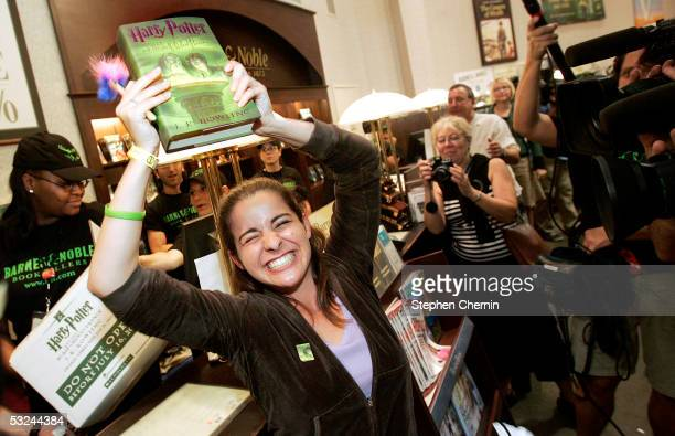 Rachel Grandi celebrates after she was the first to buy the new Harry Potter book at the Barnes and Noble in Union Square July 15 2005 in New York...