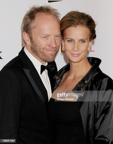 Rachel Griffiths and Andrew Taylor arrive at the Los Angeles Philharmonic Inaugural Gala on October 8 2009 in Los Angeles California