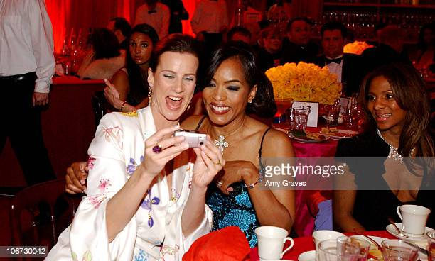 Rachel Griffiths and Angela Bassett during Elton John AIDS Foundation's 11th Annual Oscar party cohosted by In Style and AOL in association with MAC...