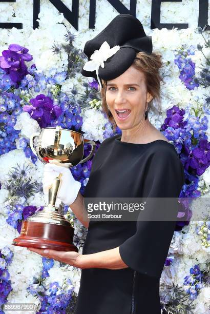 Rachel Griffiths poses with the Melbourne Cup at the Kennedy Marquee on Derby Day at Flemington Racecourse on November 4 2017 in Melbourne Australia