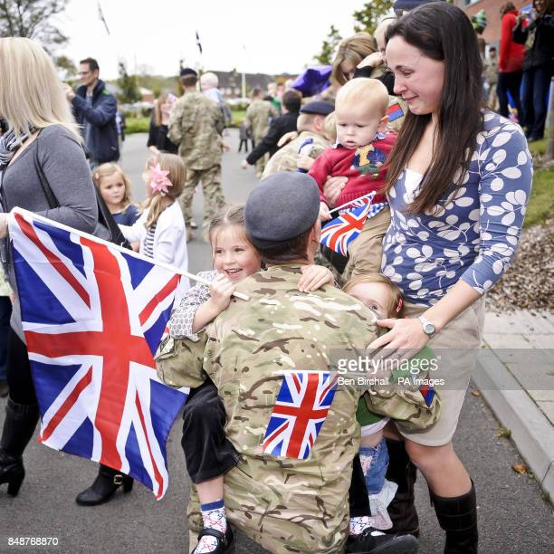 Rachel Haines holding her son Morgan aged one show emotion as her daughters Elise aged five Amelie aged three hug their father Major Ross Haines as...
