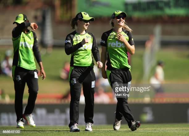 Rachel Haynes and Nicola Carey of the Thunder celebrate victory as they leave the field after the Women's Big Bash League WBBL match between the...