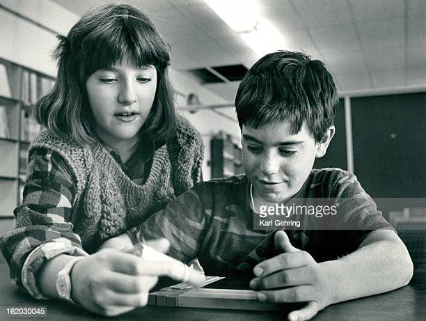 MAR 17 1985 Rachel Hayutin and Arthur Allison worked together on math problem Using blocks and constructing a square with the blocks helps find the...