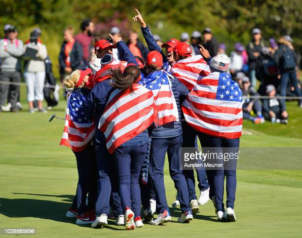 Rachel Heck of Team USA celebrates with team mates as her victory sees the United States win the trophy during the singles on day two of the 2018...