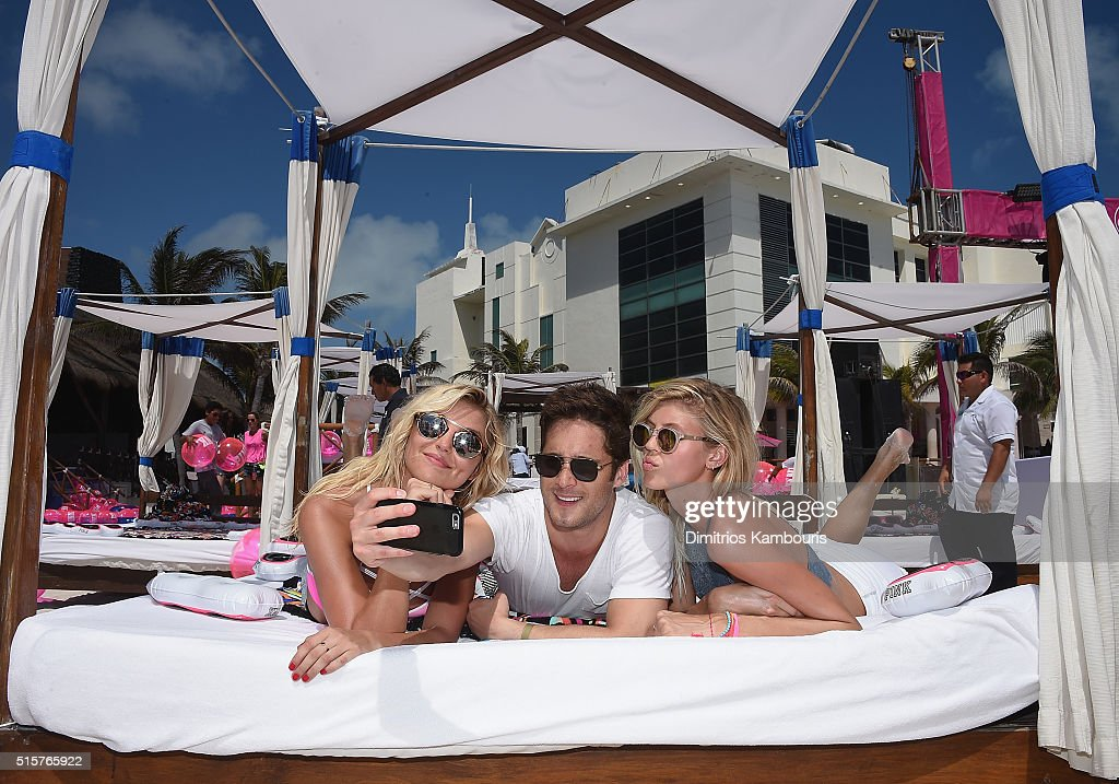 Rachel Hilbert, Diego Boneta and Devon Windsor attend Victoria's Secret PINK Nation Spring Break Beach Party in Cancun, Mexico on March 15, 2016 in Cancun, Mexico.