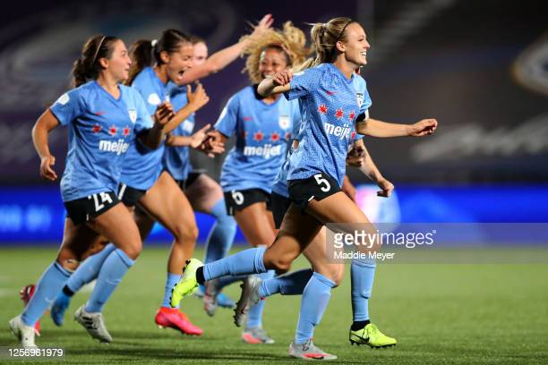 Rachel Hill of Chicago Red Stars celebrates with her teammates after defeating the OL Reign FC during penalty kick in the quarterfinal match of the...