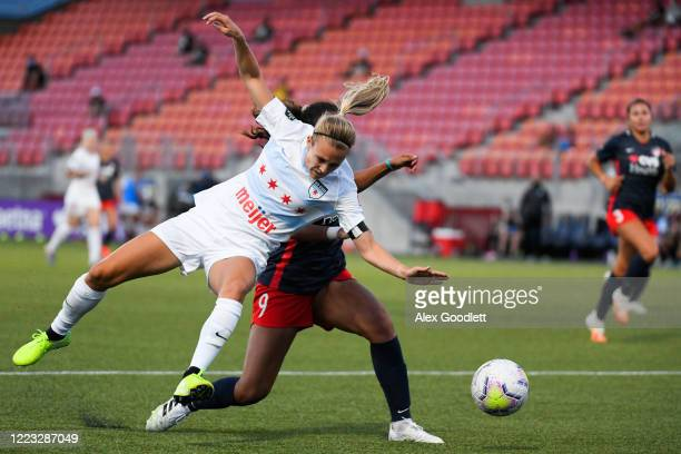 Rachel Hill of Chicago Red Stars fights for the ball with Tegan McGrady of Washington Spirit during a game in the first round of the NWSL Challenge...