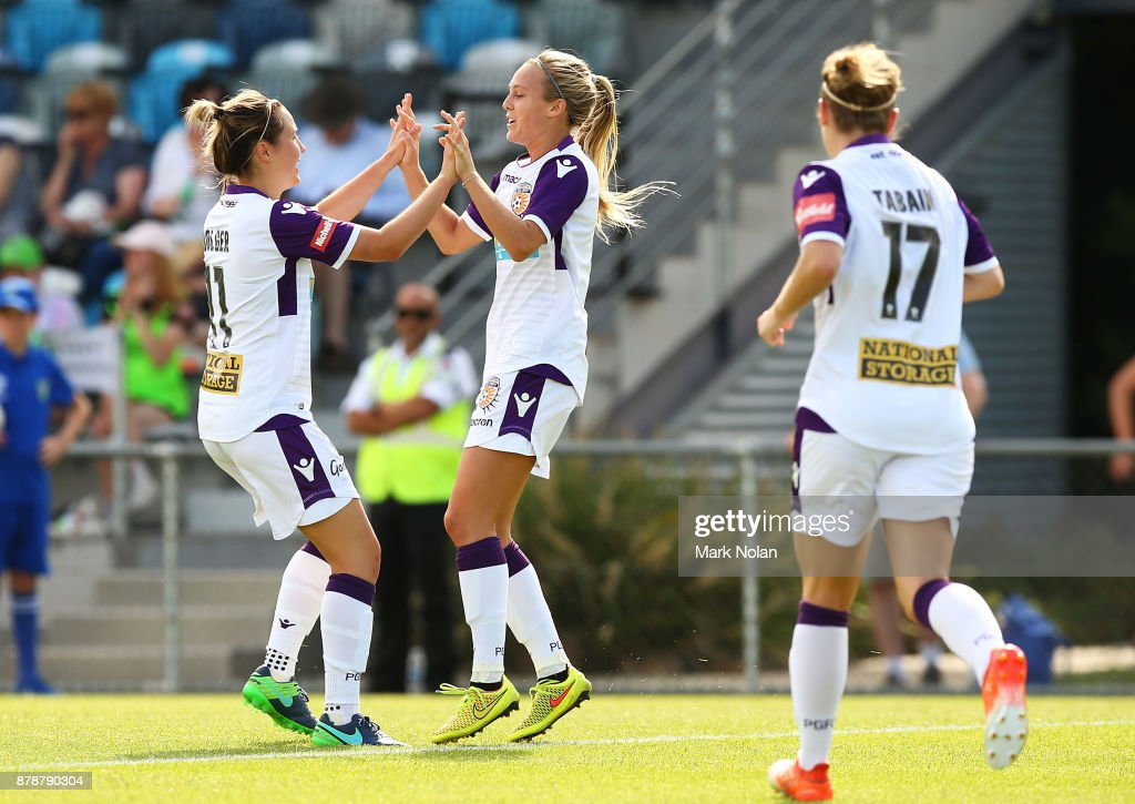Rachel Hill of Perth (R) celebrates a goal with team mates during the round five W-League match between Canberra United and Perth Glory at McKellar Park on November 25, 2017 in Canberra, Australia.