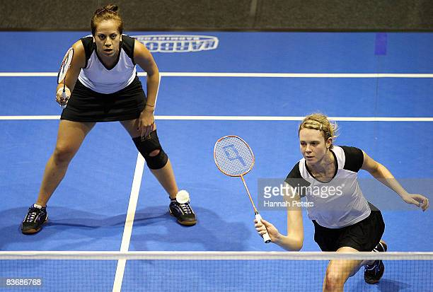Rachel Hindley of New Zealand plays a shot as her partner Renee Flavell of New Zealand looks on during their Women's Doubles Semi Finals match...