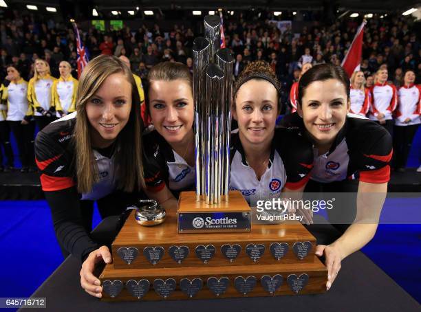 Rachel Homan Emma Miskew Joanne Courtney and Lisa Weagle of Ontario celebrate victory with the Championship Trophy following the Gold Medal match...