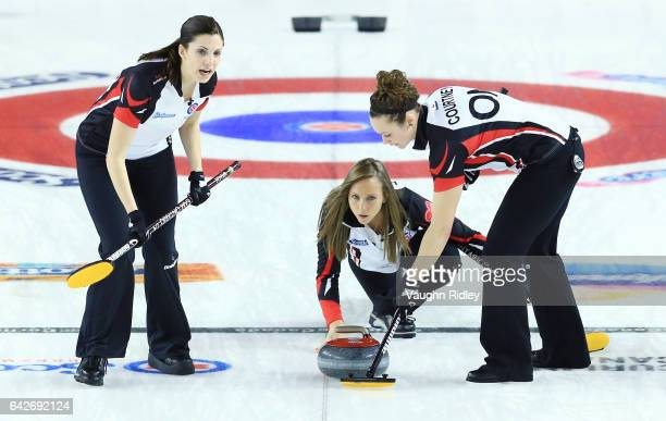 Rachel Homan of Canada delivers a stone as Lisa Weagle and Joanne Courtney sweep in a draw one match against Ontario during the 2017 Scotties...