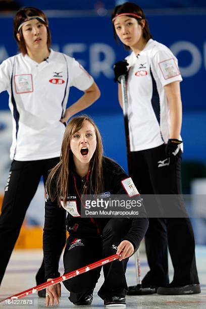 Rachel Homan of Canada gives team mates instructions as Emi Shimizu and Chiaki Matsumura of Japan watch the shot in the match between Japan and...