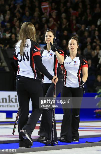 Rachel Homan of Ontario celebrates a shot with Lisa Weagle and Joanne Courtney in the Gold Medal match against Manitoba during the 2017 Scotties...