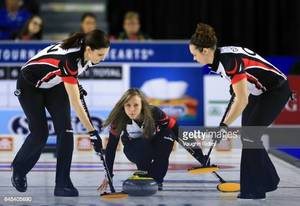 Rachel Homan of Ontario delivers a stone as Lisa Weagle and Joanne Courtney sweep in a semi final match against Northern Ontario during the 2017...