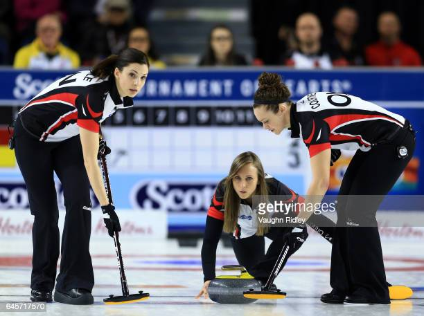 Rachel Homan of Ontario delivers a stone as Lisa Weagle and Joanne Courtney sweep in the Gold Medal match against Manitoba during the 2017 Scotties...