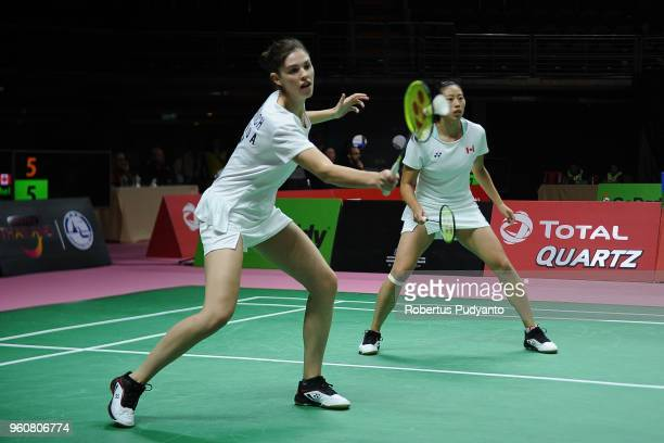 Rachel Honderich and Kristen Tsai of Canada compete against Yuki Fukushima and Sayaka Sato of Japan during Preliminary Round on day two of the BWF...