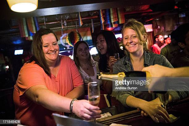 Rachel Howald Kate Lummus Virginia Sin and Gretchen Menter celebrate after the Supreme Court ruled key portions of the Defense of Marriage Act...