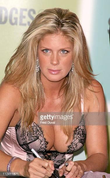 Rachel Hunter blonde long hair bustier corset lace cleavage