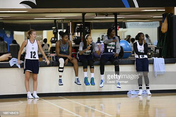 Rachel Jarry Jessica Adair Seimone Augustus Amber Harris and Ta'Shauna Rodgers of the Minnesota Lynx react to a play at practice during 2013 WNBA...