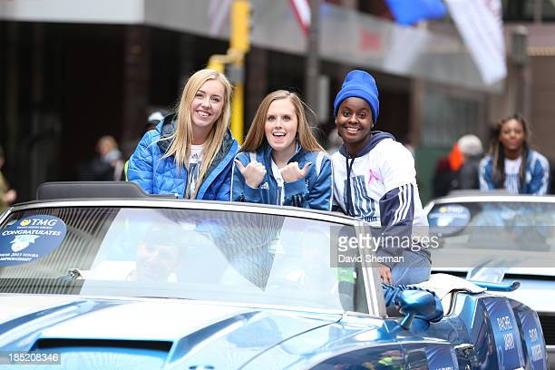 Rachel Jarry Lindsey Moore and Sugar Rogers of the 2013 WNBA Champion Minnesota Lynx ride in the Championship Parade through downtown Minneapolis at...
