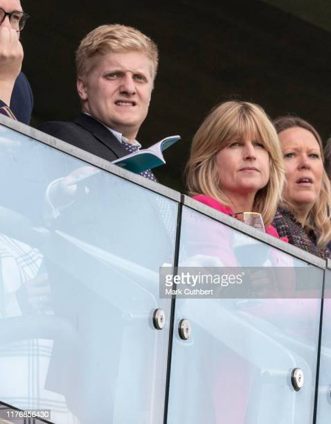 Rachel Johnson and her son Oliver Dawnay attend the QICPO British Champions Day at Ascot Racecourse on October 19 2019 in Ascot England