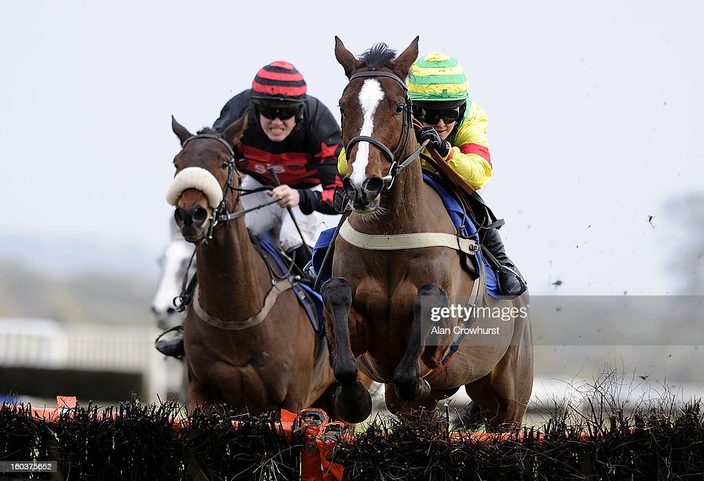 Rachel King riding Drussell (R) win The AJA Amateur Riders' Handicap Hurdle Race at Ludlow racecourse on January 30, 2013 in Ludlow, England.