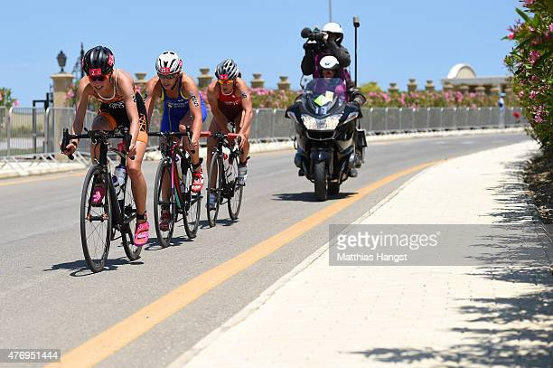 Rachel Klamer of Netherlands Lisa Norden of Sweden and Nicola Spirig of Switzerland ride in the Women's Triathlon Final during day one of the Baku...