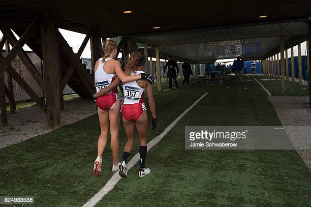 Rachel Koon and Erika Kemp of North Carolina State University embrace following the Division I Women's Cross Country Championship held at the Wabash...