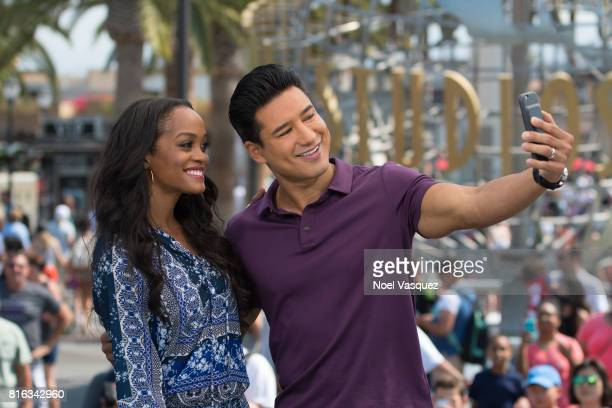 """Rachel Lindsay and Mario Lopez take a selfie together at """"Extra"""" at Universal Studios Hollywood on July 17, 2017 in Universal City, California."""