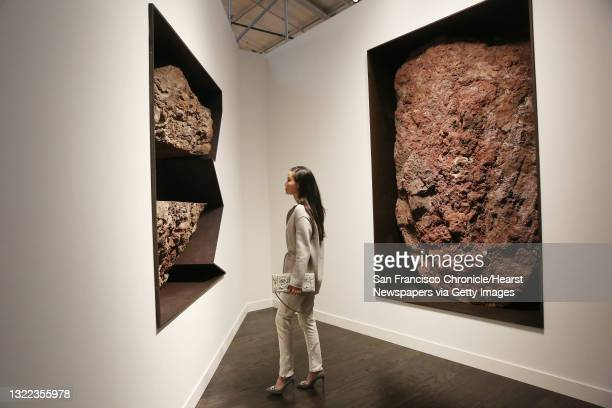 Rachel Lloyd of San Francisco looks at work by Michael Heizer at the Gagosian exhibit at FOG Design+Art in the Fort Mason Festival Pavilion on...