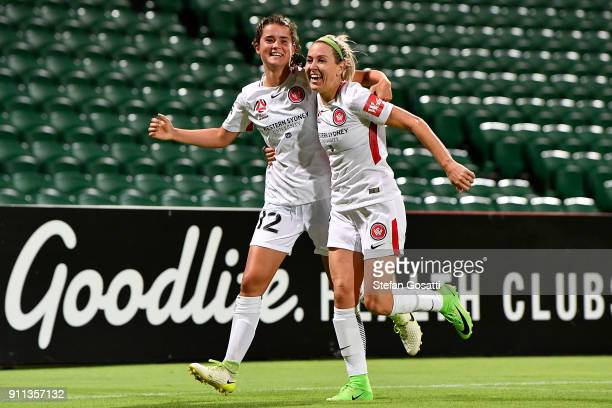 Rachel Lowe congratulates Erica Halloway of the Wanderers after scoring during the round 13 WLeague match between the Perth Glory and the Western...