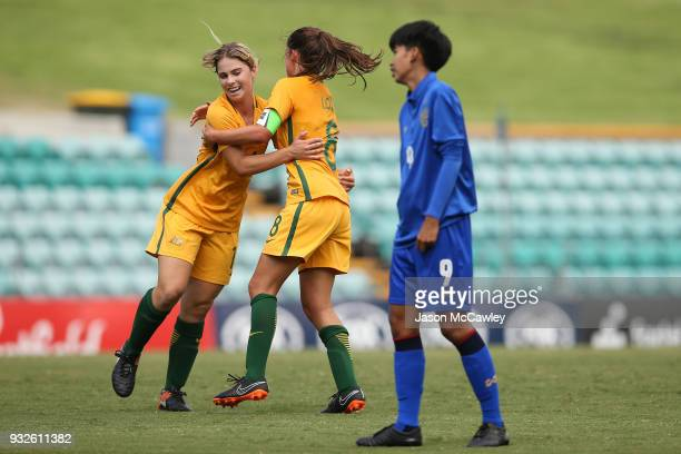 Rachel Lowe of Australia celebrates with team mates after scoring a goal during the International match between the Young Matildas and Thailand at...