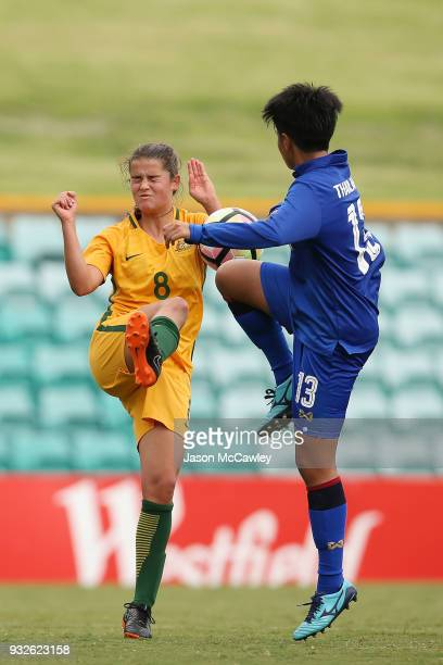 Rachel Lowe of Australia is challenged by Panittha Jeerantanapavibul of Thailand during the International match between the Young Matildas and...