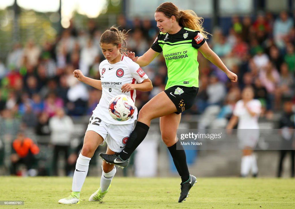 Rachel Lowe of the Wanderers and Grace Maher of Canberra contest possession during the round 11 W-League match between Canberra United and the Western Sydney Wanderers at McKellar Park on January 14, 2018 in Canberra, Australia.