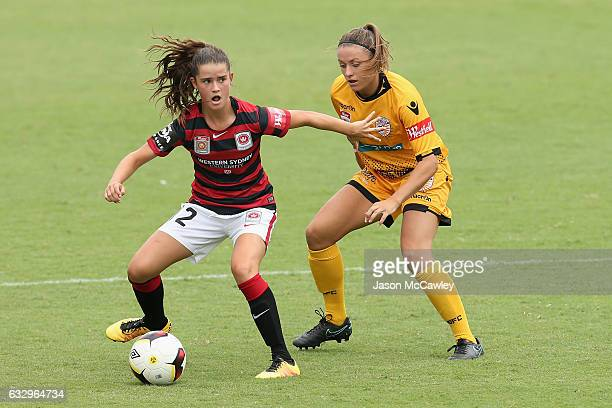 Rachel Lowe of the Wanderers is challenged by Natasha Rigby of the Glory during the round 14 WLeague match between the Western Sydney Wanderers and...