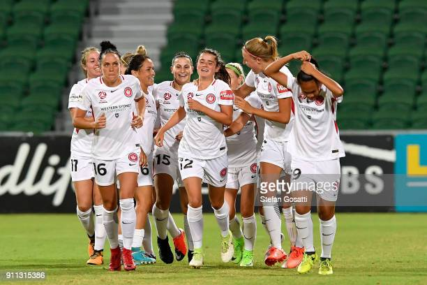 Rachel Lowe of the Wanderers is congratulated by team mates after scoring during the round 13 WLeague match between the Perth Glory and the Western...