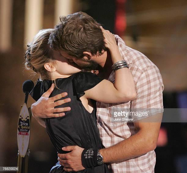 Rachel McAdams winner of Choice Movie Chemistry Liplock and Love Scene for 'The Notebook' kisses presenter Ryan Reynolds during the 2005 Teen Choice...