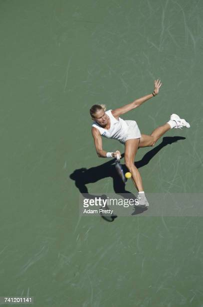Rachel McQuillan of Australia makes a forehand return against Venus Williams during their Indian Wells Masters Women's Singles fourth round match on...