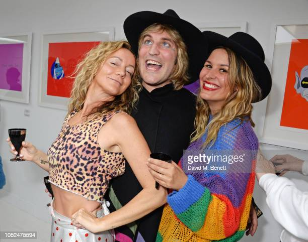 Rachel Moule Noel Fielding and Lliana Bird attend a private view of Daft Apeth by Serge Pizzorno of Kasabian at No Ho Showrooms on October 18 2018 in...