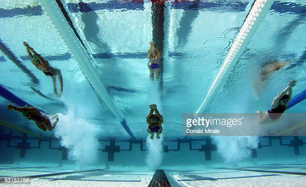 Rachel Murphy Sophie Staskiewicz and Stephanie Braun enter the pool at the start of the Women's 200M Butterfly Prelim during the Santa Clara Grand...