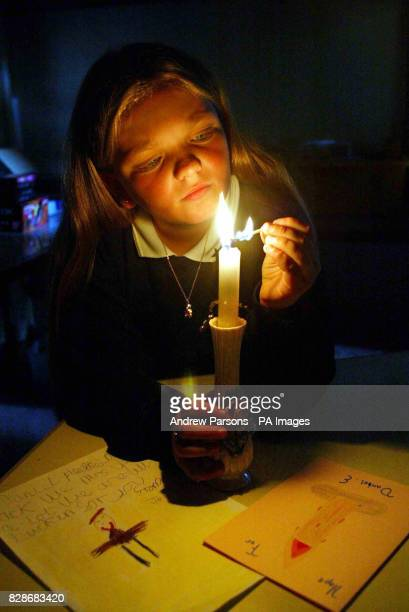 Rachel Nixon from Greenacre First Middle Nursery School in Gt Yarmouth Norfolk lights a candle of hope for fellow pupil Daniel Entwistle who has been...
