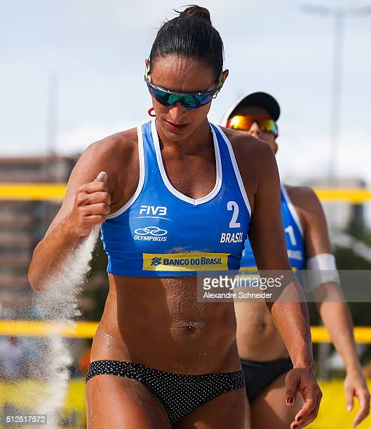 Rachel Nunes of Brazil tests the wind during the main draw match against Brazil at Pajucara beach during day four of the FIVB Beach Volleyball World...