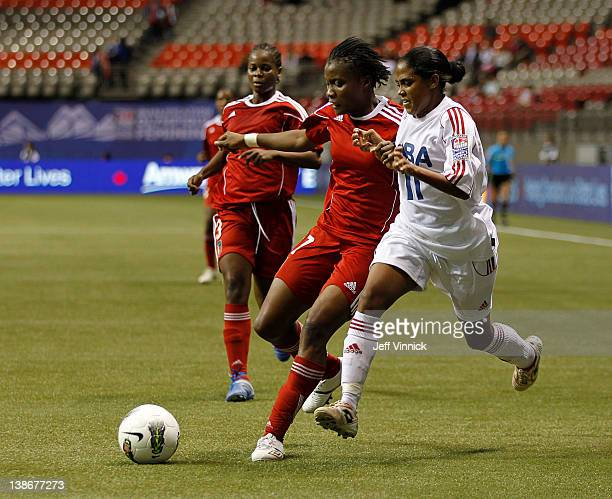 Rachel Pelaez of Cuba and Roselord Borgella of Haiti battle for the ball during the 2012 CONCACAF Women's Olympic Qualifying Tournament at BC Place...
