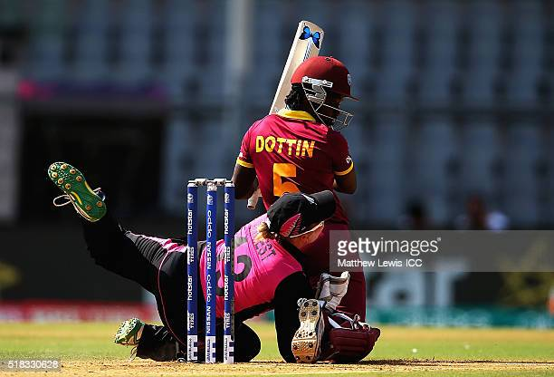 Rachel Priest of New Zealand coolides with Deandra Dottin of the West Indies during the Women's ICC World Twenty20 India 2016 Semi Final match...