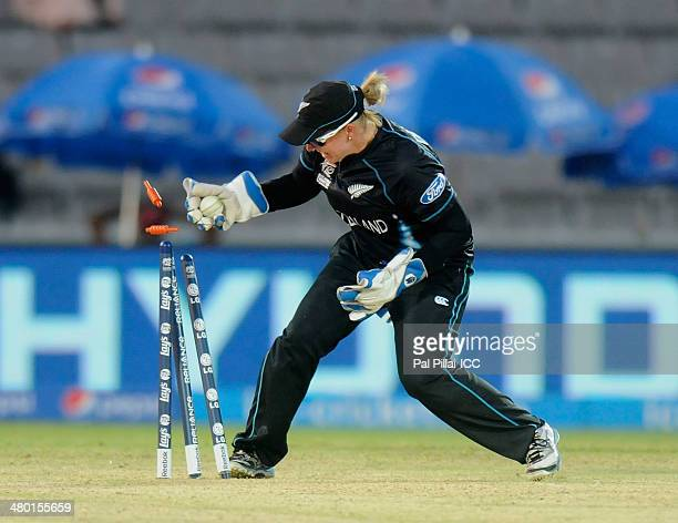 Rachel Priest of New Zealand takes the bails off to get Ellyse Perry of Australia run out during the opening match of the ICC Women's World Twenty20...