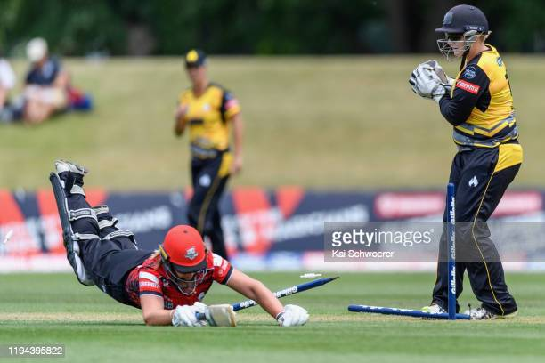 Rachel Priest of the Blaze looks on as Natalie Cox of the Magicians dives to save her wicket during the Women's T20 match between the Canterbury...